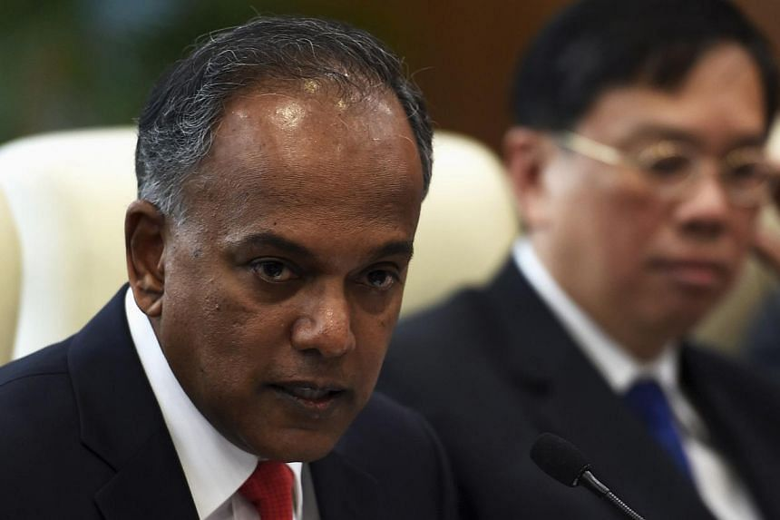 Singapore's Foreign Minister K. Shanmugam speaks during a meeting with China's Foreign Minister Wang Yi (not pictured) in Beijing on June 12, 2014. -- PHOTO: REUTERS