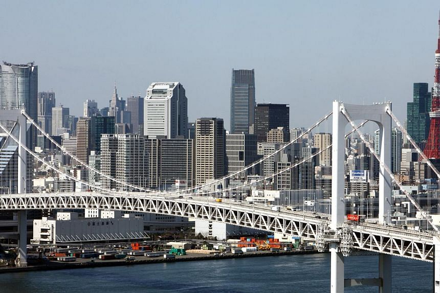 Commercial buildings stand behind the Rainbow Bridge in Tokyo, Japan, on March 11, 2010. Japan said on June 17, 2014, that it would relax visa rules for tourists from Indonesia, the Philippines and Vietnam in a bid to double the number of foreign vis