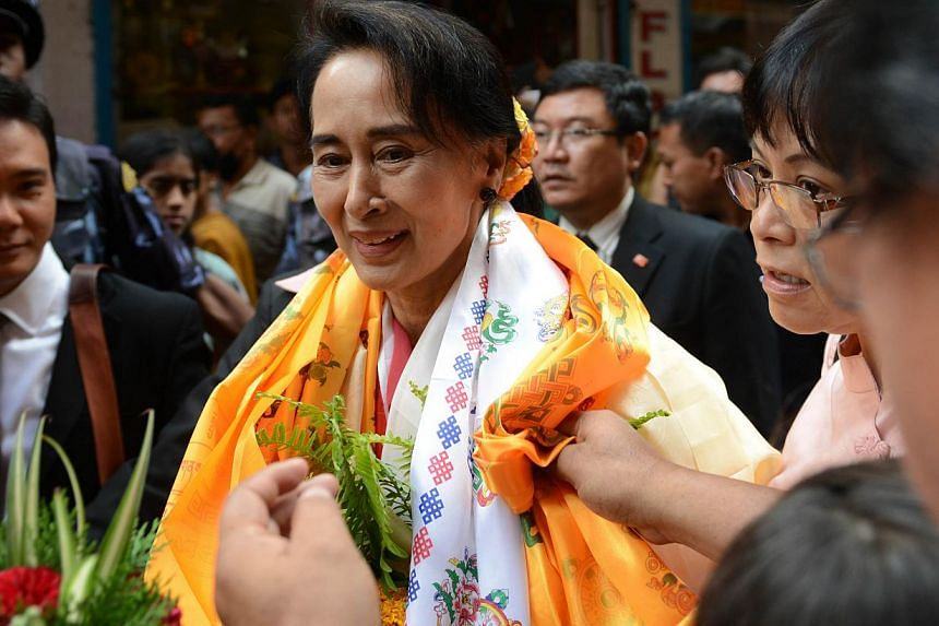 The US urged Myanmar on Monday to allow its people to freely choose the next president amid a row over a law which would ban opposition leader Aung San Suu Kyi (above) from running. -- PHOTO: AFP