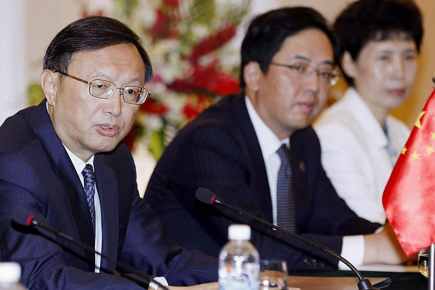 Chinese diplomat Yang Jiechi (left) speaks during a meeting with Vietnam's Foreign Minister Pham Binh Minh (not pictured) at the government's guesthouse in Hanoi on June 18, 2014. -- PHOTO: AFP