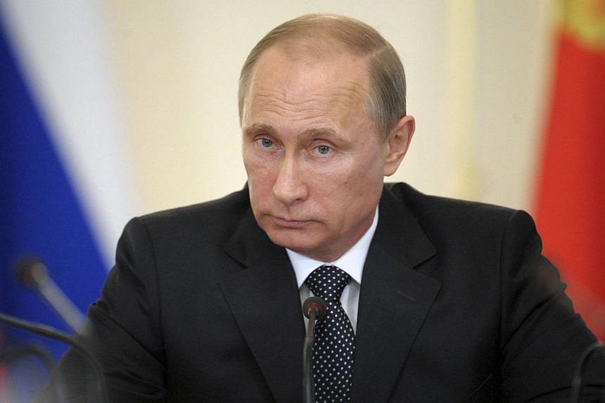 Russian President Vladimir Putin will jet to Brazil next month to take part in a handover ceremony at the end of the World Cup finals, with Russia gearing up to host the next championship, a newspaper report said on Wednesday, June 18, 2014. -- PHOTO