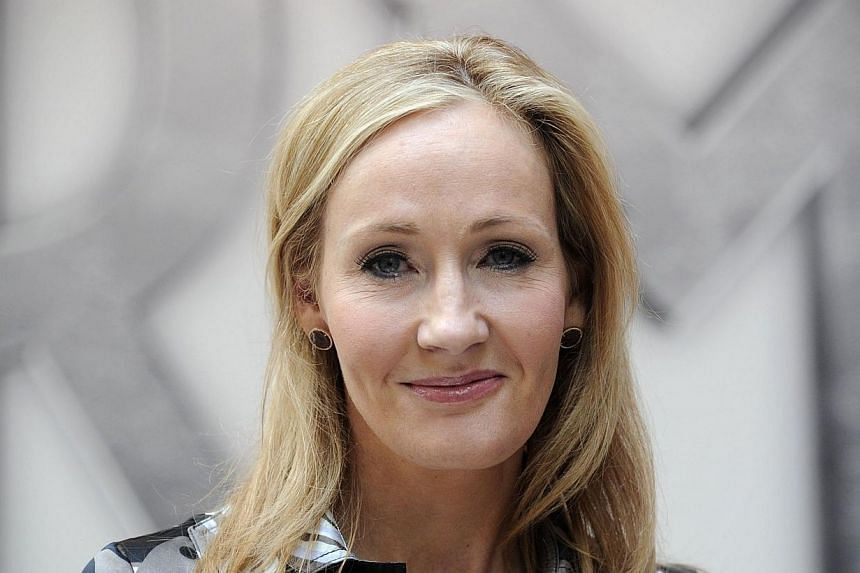 Harry Potter creator J.K. Rowling poses for photographers during the launch of her new project 'www.pottermore.com' in central London on June 23, 2011. -- PHOTO: AFP
