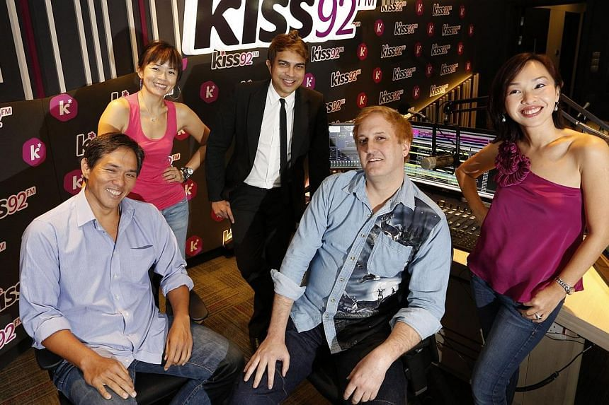 DJs (from left) Arnold Gay, Melody Chen, John Klass, Jason Johnson, and Maddy Barber helped Kiss92 emerge as Singapore's No. 1 English music station in the latest Nielsen radio survey results, released on Wednesday, June 18, 2014. -- PHOTO: