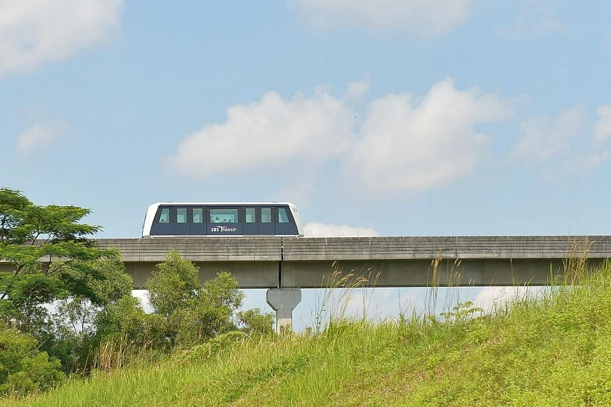 A LRT train on the move in Punggol estate. Part of the Punggol West LRT line will open on June 29, giving residents there another option to get to Punggol MRT station or bus interchange. -- PHOTO: ST FILE