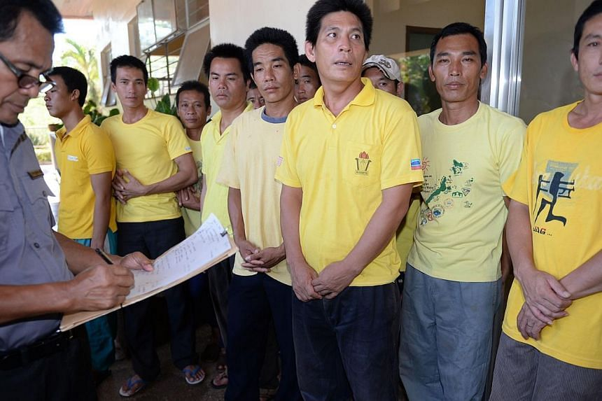 Vietnamese fishermen (right), who were arrested on March 21 with a boatload of sharks off the western island of Palawan, waiting for their court hearing to start in Puerto Princesa, Palawan island on June 4, 2014.A Philippine court on Wednesday