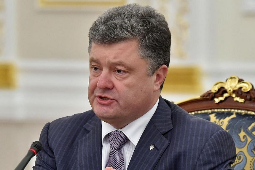 Ukrainian President Petro Poroshenko speaks during a National Security and Defence Council sitting in Kiev on June 16, 2014. Ukrainian President Petro Poroshenko asked parliament on Wednesday to dismiss the country's central bank governor, Stepan Kub