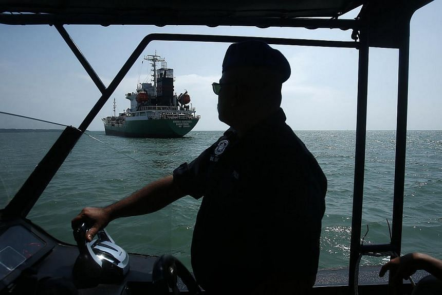 A Japanese oil tanker which was raided by armed pirates sailing in Port Klang, outside Kuala Lumpur, in April. In responding to piracy, the focus should not only be on the diplomatic and naval steps, but also on legal, economic and social factors.