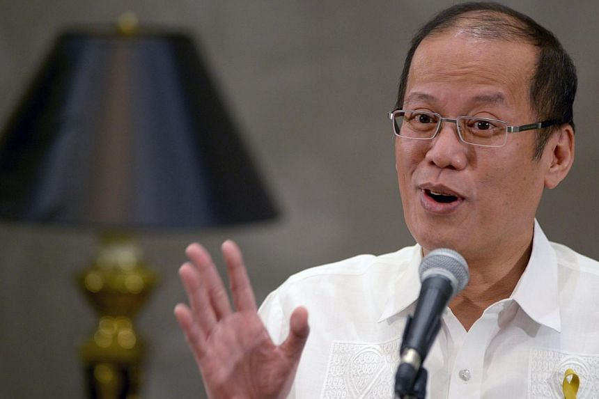 Philippine President Benigno Aquino gestures as he speaks to reporters on the sidelines of an Asia-Europe meeting in Manila on June 5, 2014. Philippine President Benigno Aquino will visit Japan next week, with the row over China's territorial am