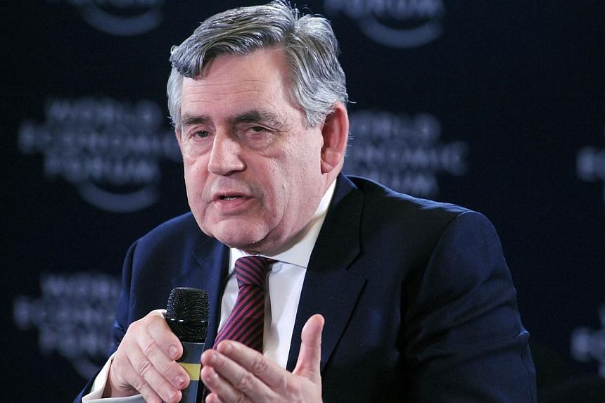 "Former British Prime Minister and UN education envoy Gordon Brown speaks about ""Safe Schools Initiative"" at the World Economic Forum in Abuja on May 7, 2014. -- PHOTO: AFP"
