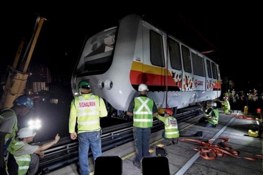 The first of 13 new train cars for the system arrived in Singapore on Sunday, with the rest due over the new few months. -- PHOTO: LAND TRANSPORT AUTHORITY