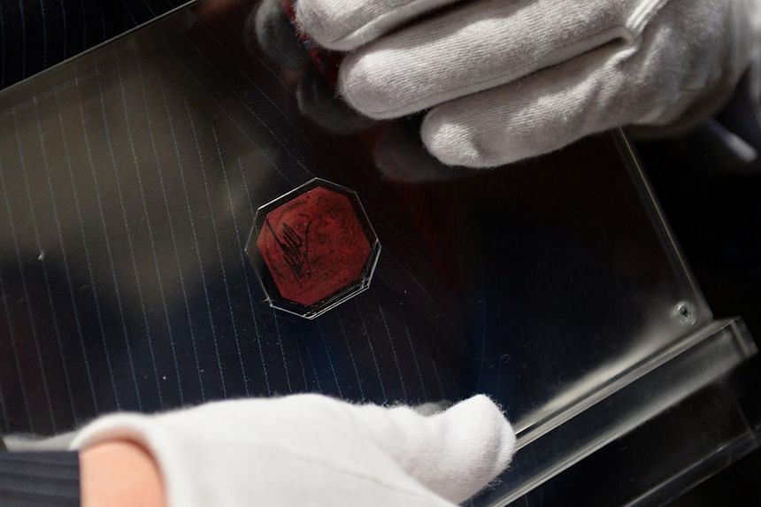 Mr David Redden, Sotheby's Vice-Chairman, holds the British Guiana One-Cent Magenta after it sold for US$9.5 million at Sotheby's June 17, 2014 in New York. Described as the most famous stamp in the world, no stamp is rarer than the sole-surviving ex