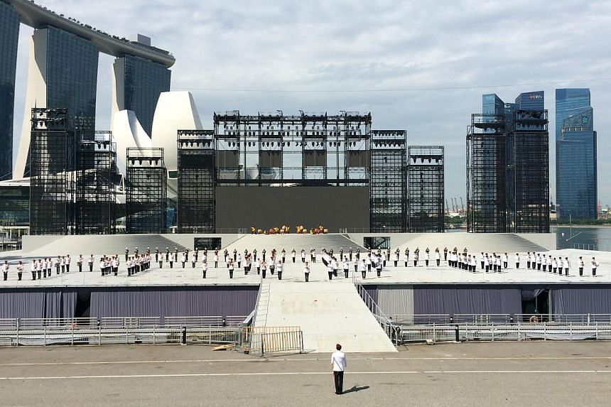 The parade and ceremony segment of this year's NDP will start with a seven-minute-long display by the Combined Band and SAF Precision Drill Squad. -- ST PHOTO: LEE JIAN XUAN