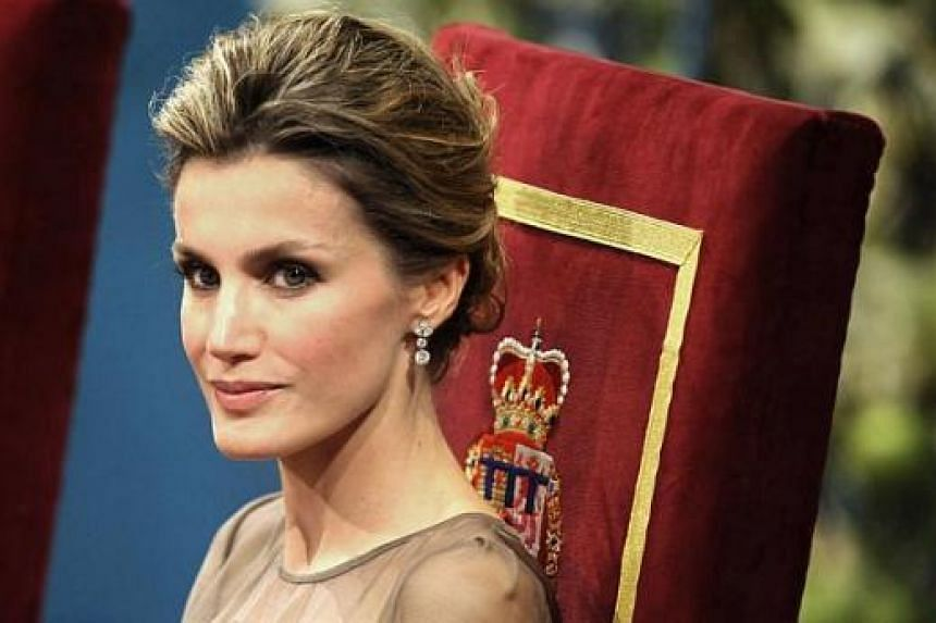 Princess Letizia of Spain attending the 2011 Prince of Asturias awards ceremony at the Campoamor Theater, in Oviedo on Oct 21, 2011. Princess Letizia will break the mould of the classic royal when she is crowned queen of Spain. -- PHOTO: AFP