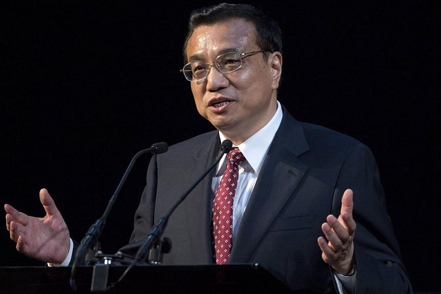 "Chinese Premier Li Keqiang delivers a speech at a China-Britain Business Council dinner in London on June 17, 2014. Chinese Premier Li Keqiang said Tuesday he wanted to see a ""united"" Britain, as Scotland prepares to vote on independence. --"