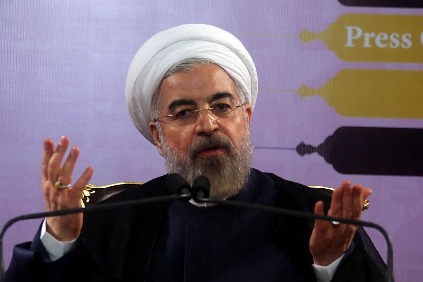 Iranian President Hassan Rouhani speaks during a press conference in the capital Tehran on June 14, 2014. He said on Wednesday that Iran would do whatever it takes to protect revered Shiite shrines in Iraq against Sunni militants fighting the Ba