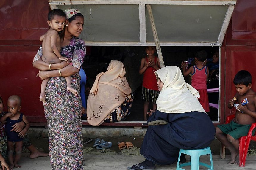 "A top United Nations envoy has raised the alarm over ""appalling conditions"" in west Myanmar displacement camps, which hold thousands of Rohingya Muslims made homeless in communal unrest two years ago. -- PHOTO: REUTERS"