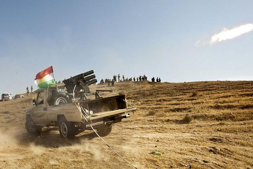 Kurdish Peshmerga forces fire missiles during clashes with militants of the Islamic State of Iraq and the Levant (ISIL) jihadist group in Jalawla in the Diyala province, on June 14, 2014.Saudi Arabia warned on Wednesday of the risks of a civil