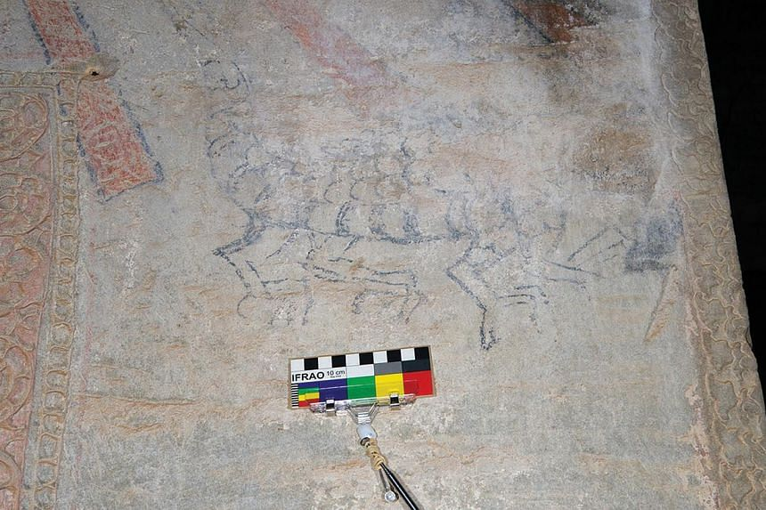 Black drawing of a zoomorph with scales and multiple legs, found in the south entrance chamber of the first enclosure.-- PHOTO:NOEL HIDALGO TAN AND ANTIQUITY PUBLICATIONS