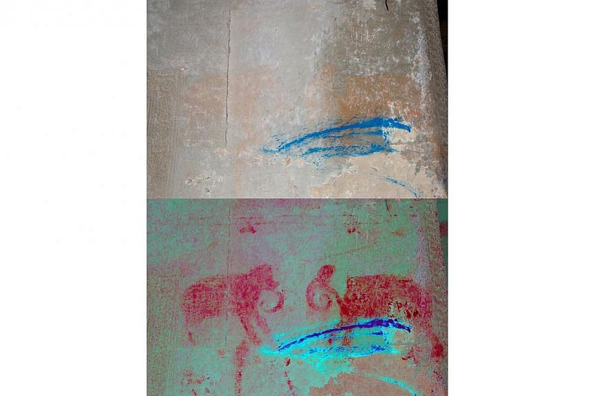 Enhanced painting of elephants found in the south entrance chamber of the first enclosure. -- PHOTO: NOEL HIDALGO TAN AND ANTIQUITY PUBLICATIONS