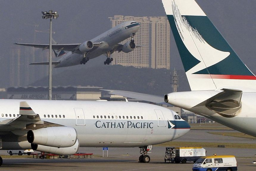 A 15-hour Cathay Pacific flight to Hong Kong proved a particular ordeal for one US passenger who accidentally trapped his middle finger in a toilet rubbish bin early Wednesday, police said. -- PHOTO: BLOOMBERG