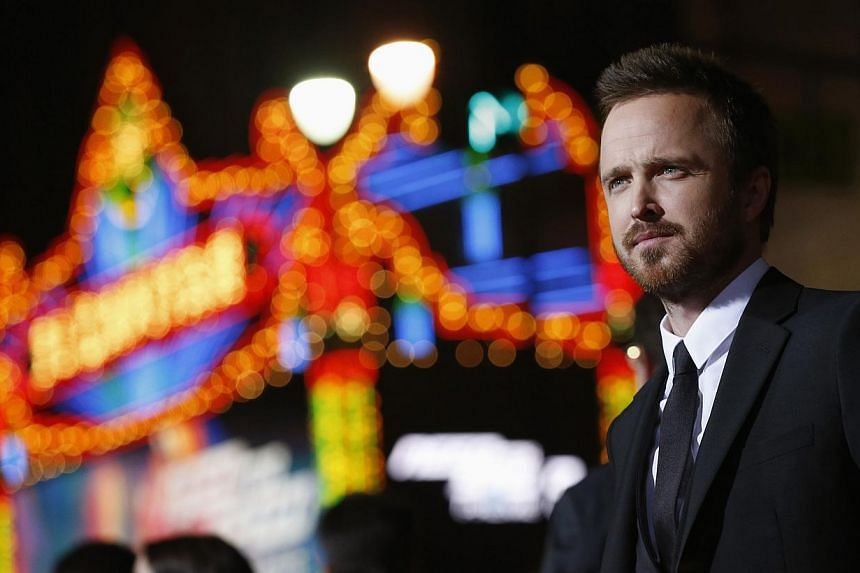 """Cast member Aaron Paul poses at the premiere of the film """"Need for Speed"""" in Hollywood, California in this file photo taken March 6, 2014. For Paul, life after """"Breaking Bad"""" has brought him more of the dark, broken characters that he became known fo"""