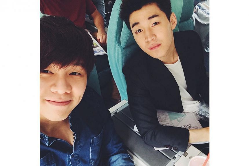 Singaporean songwriter Gen Neo (left) and Henry Lau of K-pop group Super Junior-M. Mr Neo has been based in Seoul for the past one-and-a-half years and written tunes for Super Junior-M and f(x).-- PHOTO: GEN NEO