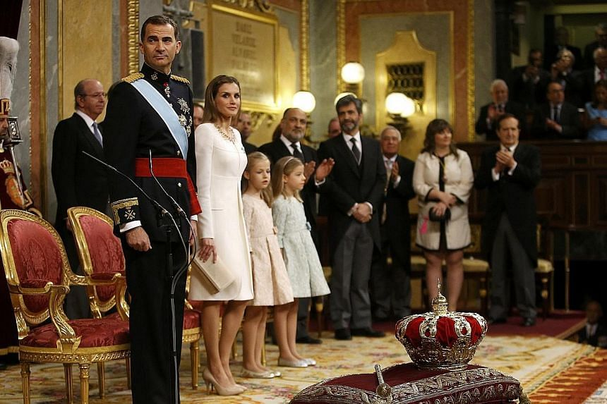 Spain's new King Felipe VI, his wife Queen Letizia, Princess Sofia and Princess Leonor attend the swearing-in ceremony at the Congress of Deputies in Madrid on June 19, 2014. -- PHOTO: REUTERS