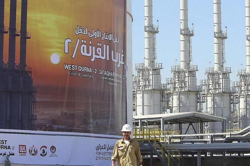 A worker walks in West Qurna oilfield in Iraq's southern province of Basra on March 29, 2014.Oil prices soared Thursday, June 19, 2014, to a new nine-month high point on escalating violence in Iraq, as militants attacked the major crude produce