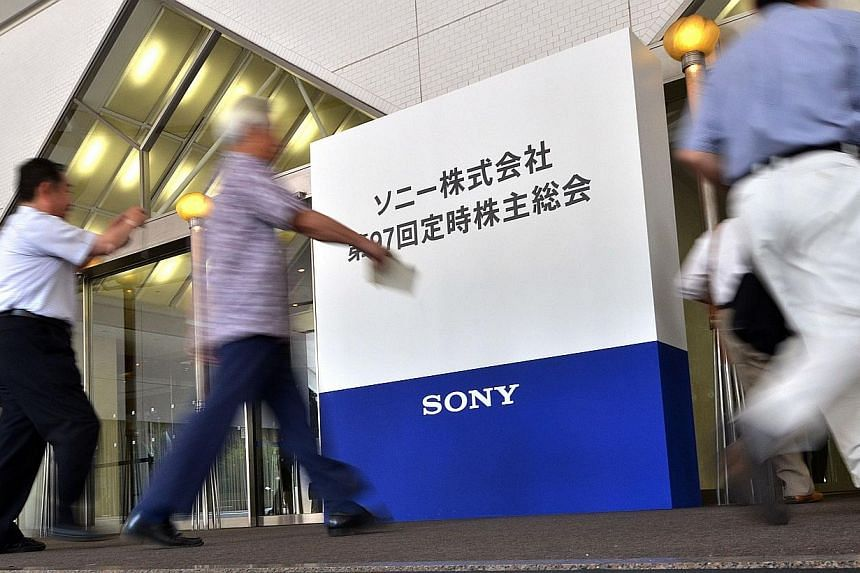 People arrive for a shareholders meeting for Japan's electronics giant Sony in Tokyo on June 19, 2014. Some of Japan's best-known companies, such as Sony, Japan Airlines and fast-food chain Yoshinoya, are seeing attendance plummet at their shar