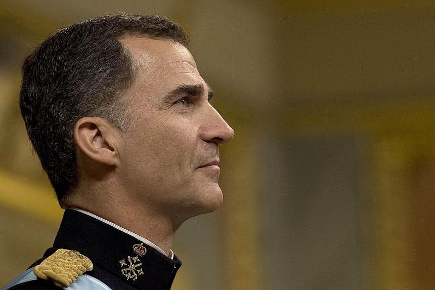 Spain's King Felipe VI stands during a swearing in ceremony for FelipeVI King of Spain at the Congress of Deputies, Spain's lower House in Madrid on June 19, 2014. -- PHOTO: AFP