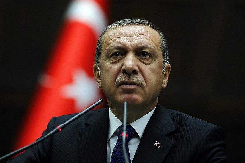 Turkey's Prime Minister Tayyip Erdogan addresses members of parliament from his ruling AK Party (AKP) during a meeting at the Turkish parliament in Ankara on June 3, 2014. -- PHOTO: REUTERS