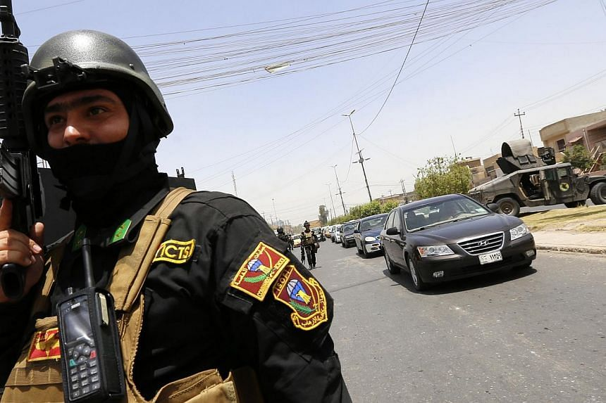 A member of the Iraqi Special Operations Forces stands guard during an intensive security deployment in Baghdad's Amiriya district, June 18, 2014. -- PHOTO: REUTERS
