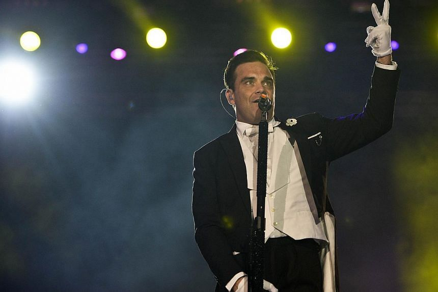 British singer Robbie Williams performs at the Rock in Rio Lisboa music festival at Bela Vista Park in Lisbon on May 25, 2014. -- PHOTO: AFP