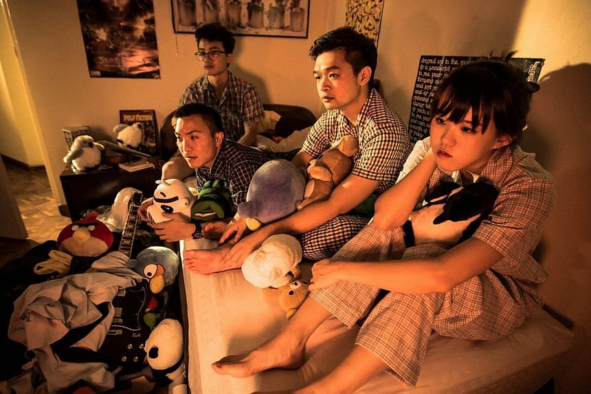 Lost Weekend's (from far left) Ng Zheng Jie (in glasses), 22, drummer; Mark Cheng, 28, bassist; Arif Atmadja, 28, guitarist; and Rachel Tan, 26, vocalist, guitarist and keyboardist.