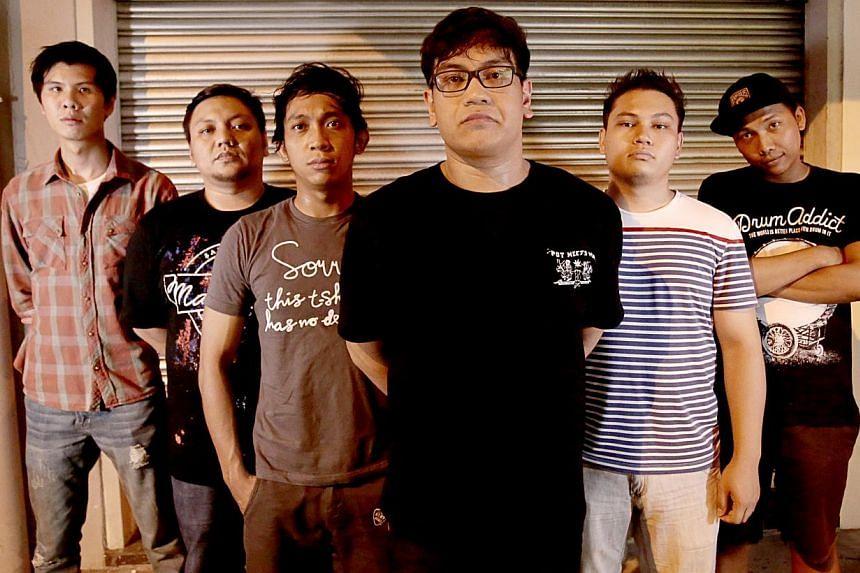Attention! The New Portsdown's (from left) Isaac Chew, 26, keyboardist and synthesizer player; Muhammad Nurikhwan Sahri, 31, bassist; Abdul Rahman Muhammad, 29, guitarist; Muhammad Nurasyraf Sahri, 24, vocalist; Muhammad Kamaruizan Kassim, 27, guitar