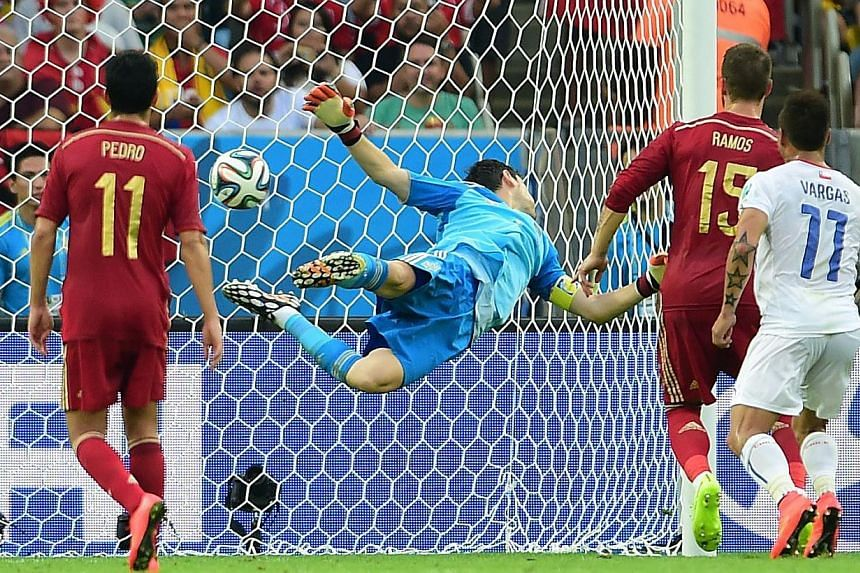 Spain's goalkeeper and captain Iker Casillas fails to save a goal during a Group B football match between Spain and Chile in the Maracana Stadium in Rio de Janeiro during the 2014 FIFA World Cup on June 18, 2014. -- PHOTO: REUTERS