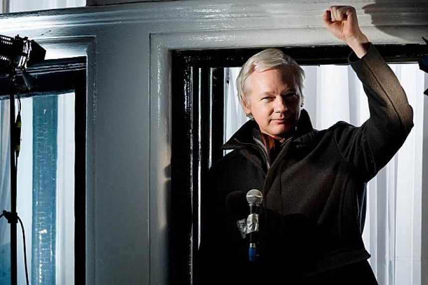 In this file picture taken on Dec 20, 2012 Wikileaks founder Julian Assange addresses members of the media and supporters from the window of the Ecuadorian embassy in Knightsbridge, west London. -- PHOTO: AFP