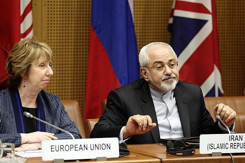European Union Foreign Policy Chief Catherine Ashton (left) and Iranian Foreign Minister Mohammad Javad Zarif wait for the begin of talks in Vienna June 17, 2014. -- PHOTO: REUTERS