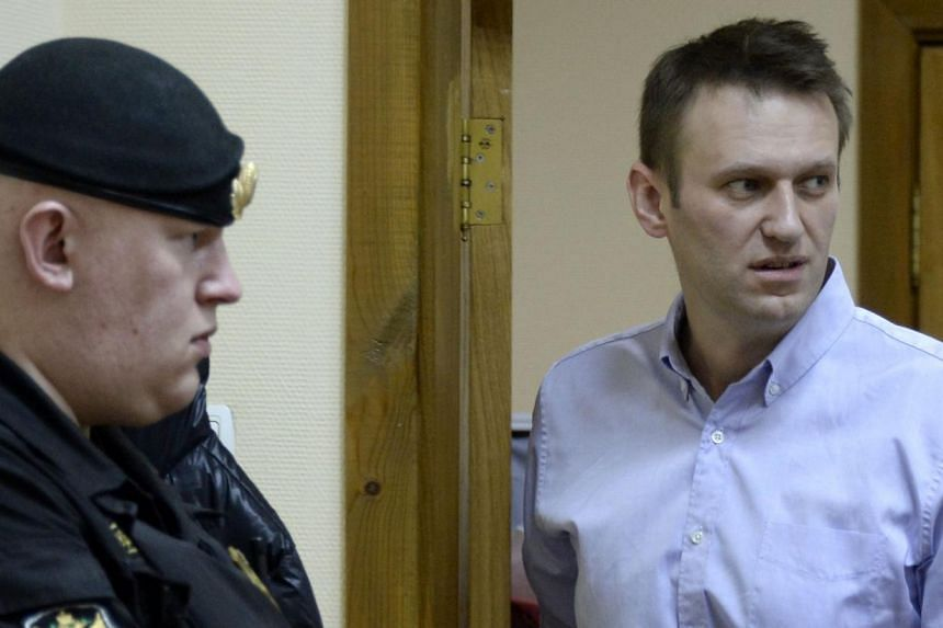 Kremlin critic and opposition leader Alexei Navalny (right) at a court hearing. Friday's search was tied to yet another probe against him in which he is alleged to have defrauded an opposition party eight years ago.PHOTO: AFP
