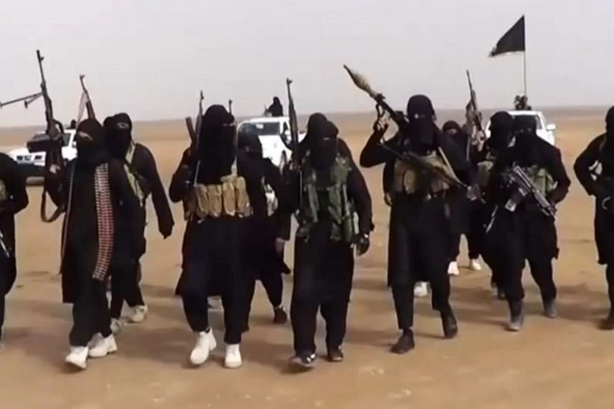 An image grab taken from a propaganda video uploaded on June 11 by jihadist group the Islamic State of Iraq and the Levant (ISIL) allegedly showing ISIL militants. ISIL militants are said to have taken control of one of Saddam Hussein's former chemic