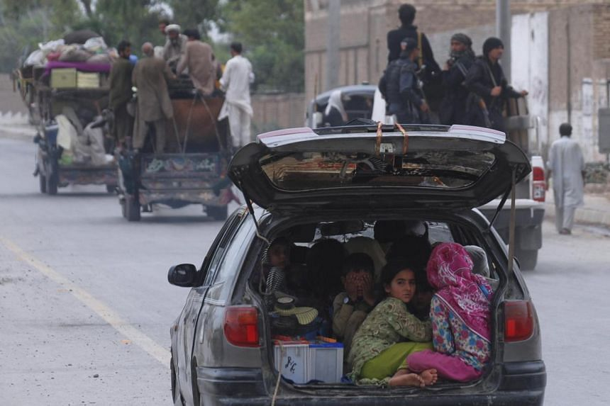 Children fleeing the military offensive against Pakistani militants in North Waziristan this week with their family members entering Bannu, in Pakistan's Khyber-Pakhtunkhwa province. Authorities had eased a shoot-on-sight curfew to give civilians a c