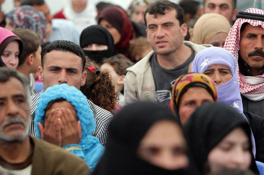 Syrian refugees waiting their turn at a United Nations Refugee Agency registration centre in Lebanon in April. Since Syria's civil war began in March 2011, a total of 2.5 million people have fled the country, with 6.5 million more displaced inside it