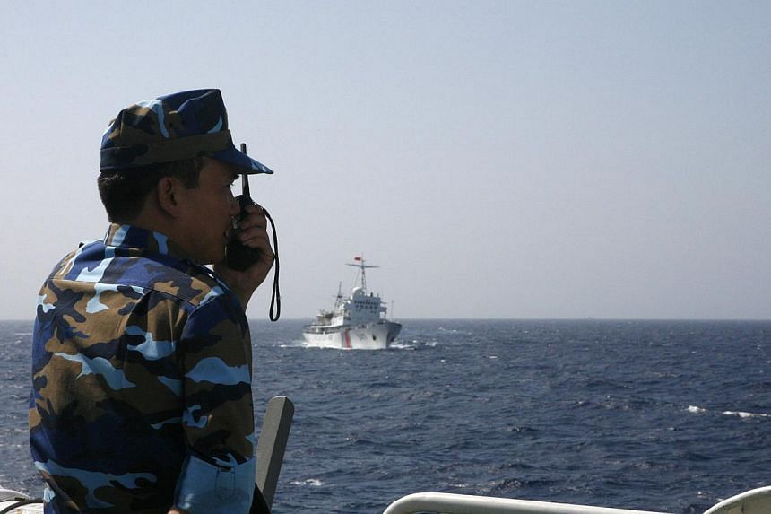 "An officer of the Vietnamese marine guard monitoring a Chinese coast guard vessel in the South China Sea, about 210km off the coast of Vietnam. China is determined to uphold the country's controversial ""nine-dashed line""."