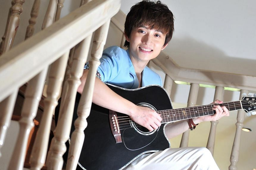 Kenny Khoo hopes to hold a big concert in Singapore one day. -- ST PHOTO: STEFFI KOH