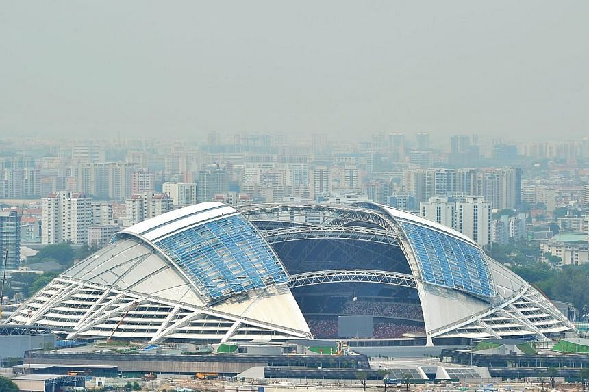 Aerial view of the Singapore Sports Hub under construction, on 29 April 2014. -- PHOTO: ST FILE
