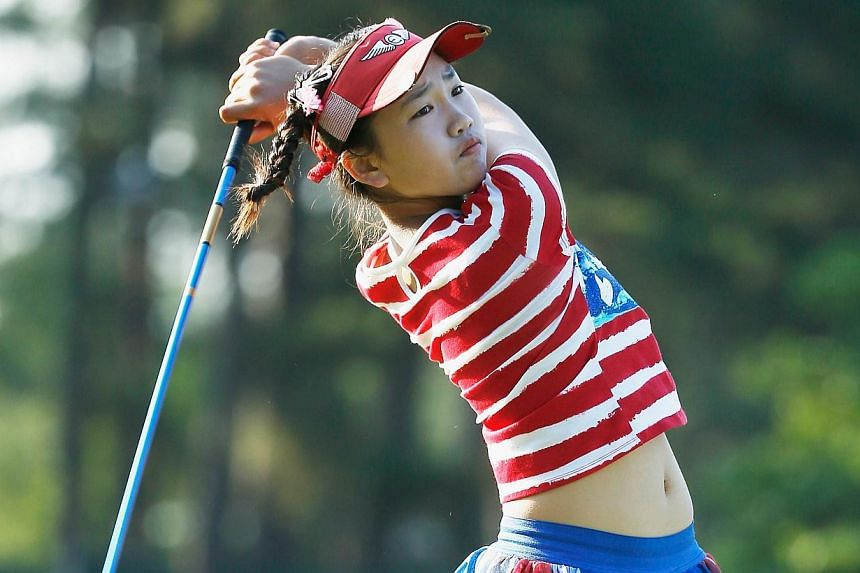 Eleven year-old Amateur Lucy Li of the United States hits her tee shot on the 13th hole during the first round of the 69th US Women's Open at Pinehurst Resort & Country Club, Course No. 2 on June 19, 2014 in Pinehurst, North Carolina. -- PHOTO: A