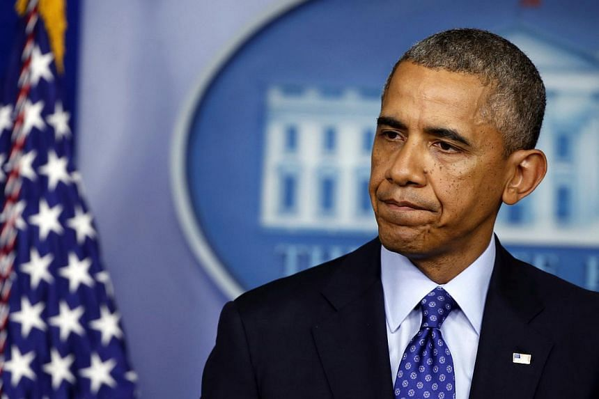 US President Barack Obama speaks about the situation in Iraq in the briefing room of the White House in Washington on June 19, 2014. -- PHOTO: REUTERS