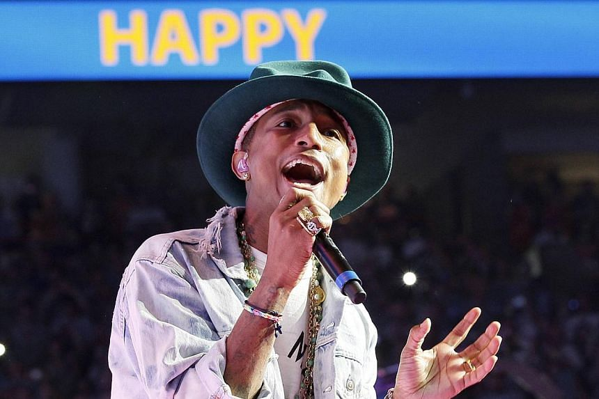 Singer Pharrell Williams performs his hit song Happy at the Walmart annual shareholders meeting in Fayetteville, Arkansas on June 6, 2014. -- PHOTO: REUTERS