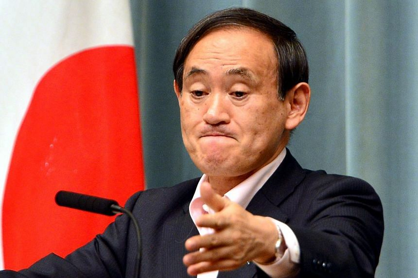 "Japan's Chief Cabinet Secretary Yoshihide Suga at a press conference in Tokyo on May 29, 2014. Mr Suga, commenting on an expert panel report, repeated that Japan would not revise the statement on the ""comfort women"". -- PHOTO: AFP"