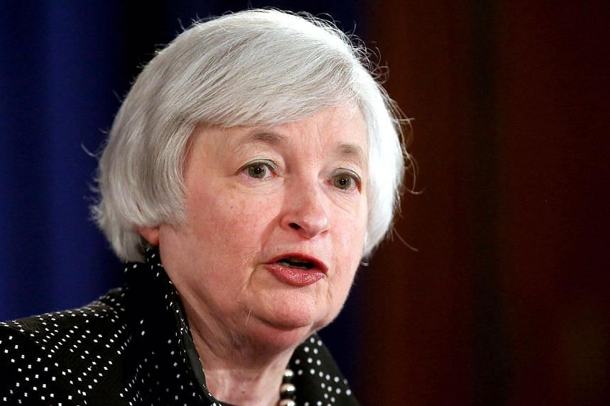 Federal Reserve chief Janet Yellen answers reporters' questions during a news conference at Fed headquarters on June 18, 2014 in Washington, DC.-- PHOTO: AFP